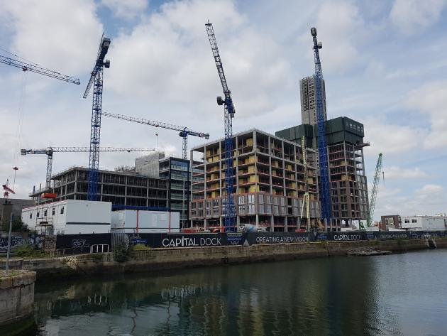 Photo of North Lotts and Grand Canal Dock with cranes in the skyline